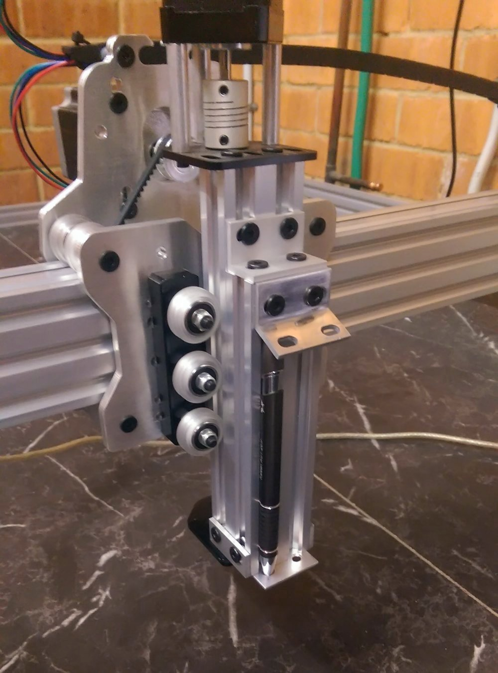 Photo of the pen holder attached to the CNC