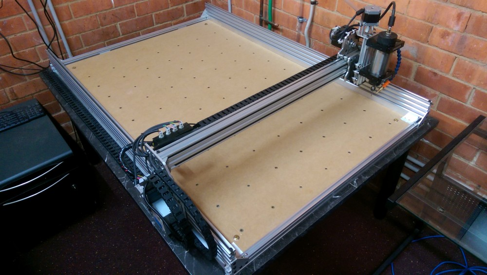 Photo of CNC bed with threaded inserts